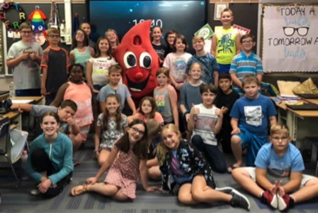 5th graders with buddy the blood drop