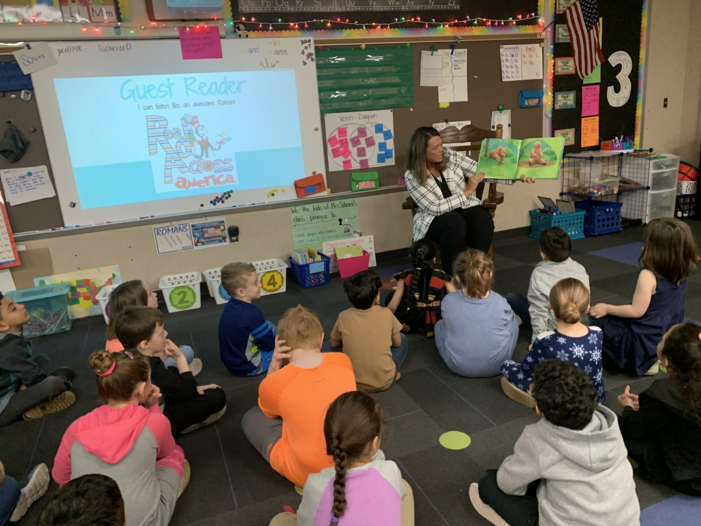 Mrs. Longenbaugh reading to 1st grade.